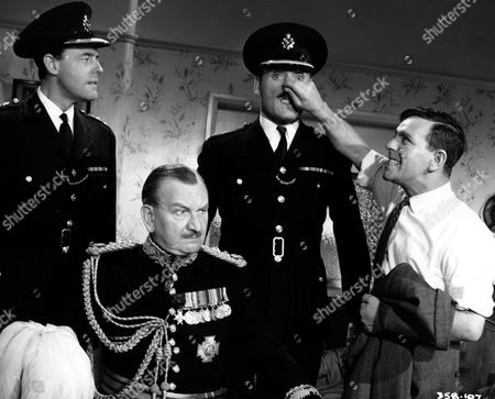 Stock Photo of 'On The Beat' Film - 1962 - Norman Wisdom, David Lodge, Terence Alexander, Raymond Huntley