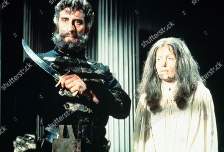 'Countess Dracula'  Film - 1971 - The Aged Countess Elizabeth (Ingrid Pitt) Stands with Her Steward Captain Dobi (Nigel Green), Who Holds a Knife