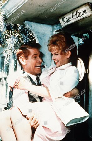 """'Father Came Too'  Film - 1964 - Dexter Munro (Stanley Baxter) Carries His Wife  Juliet Munro (Sally Smith) Over the Threshold of """"Rose Cottage"""""""