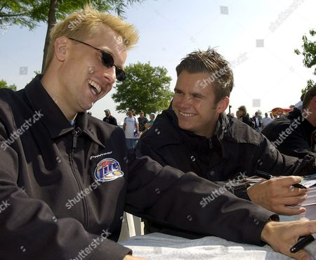 Kenny Brack of Sweden (l) and Dan Wheldon of England Laugh During an Autograph Session at the Indianapolis Motor Speedway Saturday 24 May 2003 the Drivers Will Start in the Second Row when the Race Begins on Sunday Morning Epa-photo/epa/tannen Maury United States Indianapolis