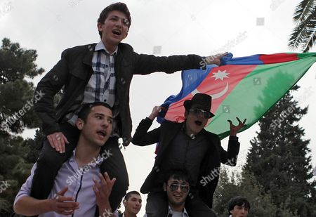 Stock Image of Azerbaijani Men Wave a National Flag Celebrating Victory by Nigar Jamal and Eldar Gasimov From Azerbaijan in the Gand Final of the 56th Eurovision Song Contest 2011 in Baku Azerbaijan 15 May 2011 Their Song Running Scared Earned Ell/nikki 221 Points During the Grand Final in Duesseldorf Germany on 14 May 2011 Ahead of Rivals From Italy and Sweden Azerbaijan Baku