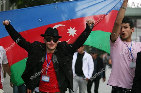 Azerbaijani Men Wave a National Flag Celebrating Victory by Nigar Jamal and Eldar Gasimov From Azerbaijan in the Gand Final of the 56th Eurovision Song Contest 2011 in Baku Azerbaijan 15 May 2011 Their Song Running Scared Earned Ell/nikki 221 Points During the Grand Final in Duesseldorf Germany on 14 May 2011 Ahead of Rivals From Italy and Sweden Azerbaijan Baku
