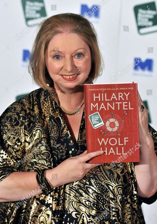 Stock Image of Winner of the 2009 Man Booker Prize British Novelist Hilary Mantel Poses For Photographers with Her Book 'Wolf Hall' After the Winner Announcement Held at London's Guildhall 6 October 2009 This Year's Shortlist Included As Byatt (the Children's Book) Jm Coetzee (summertime) Adam Foulds (the Quickening Maze) Simon Mawer (the Glass Room) and Sarah Waters (the Little Stranger) the Man Booker Prize is Britain's Most Coveted Literary Recognition and is Awarded Each Year For the Best Original Full-length Novel Written in the English Language by a Citizen of the Commonwealth of Nations Or Ireland United Kingdom London