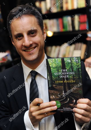Man Booker Prize For Fiction 2009 Shortlisted Author Adam Foulds Poses with a Copy of His Book 'The Quickening Maze' During a Photocall in London Britain 05 October 2009 Also in the Running Are J M Coetzee Sarah Waters Hilary Mantel a S Byatt and Simon Mawer the Winner of the Man Booker Prize Will Be Announced at 22 00 Gmt on 06 October United Kingdom London