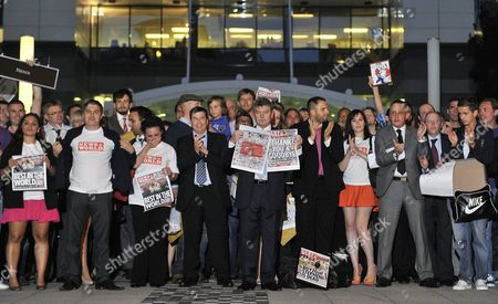 News of the World Editor Colin Myler (c) and Staff of the News of the World Leave Their Offices For the Last Time with the Final Edition of the News of the World Outside the Main Building of News International Headquarters in London Britain 09 July 2011 News of the World Will Publish Its Final Edition on Sunday 10 July Reports Stats That the British Sunday Newspaper 'The News of the World' is Doubling Its Print Run to Five Million on 10 July 2011 As the 168-year-old Newspaper Publishes Its Historic Final Edition the Paper is Closing on 10 July 2011 Following the Phone-hacking Scandal United Kingdom London