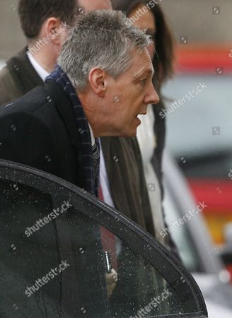Northern Ireland First Minister Peter Robinson Arrives at Stormont Parliament Buildings in East Belfast Northern Ireland 11 January 2010 Robinson is Under Increased Political Pressure Over Allegations About His Wife's Financial Affairs a Bbc Programme Asked why the Dup Leader Did not Tell the Authorities His Wife Had not Registered ú50 000 She Obtained From Two Property Developers Iris Robinson Used the Money to Help Her Young Lover Start a Business Mr Robinson Said He Will 'Resolutely Defend' Attacks on His Character and 'Contest Any Allegation of Wrongdoing' He is to Speak to the Media Later on Friday Bbc Northern Ireland's Spotlight Programme Said Iris Robinson Broke the Law by not Declaring Her Financial Interest in the Business Deal United Kingdom Belfast