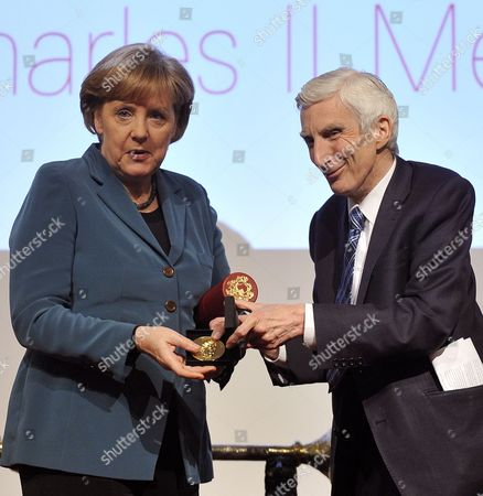 German Chancellor Angela Merkel (l) Receives the King Charles Ii Medal From Lord Martin Rees at the Royal Society in London Britain 01 April 2010 Merkel was Awarded the Honour For Her Contributions to Strengthening the Role of Science in Policy Merkel Met Earlier with Gordon Brown at His Country Residence For Talks United Kingdom London