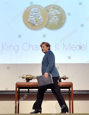 German Chancellor Angela Merkel Walks Off Stage After Receiving the King Charles Ii Medal From Lord Martin Rees at the Royal Society in London Britain 01 April 2010 Merkel was Awarded the Honour For Her Contributions to Strengthening the Role of Science in Policy Merkel Met Earlier with Gordon Brown at His Country Residence For Talks United Kingdom London