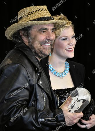 Canadian Producer Daniel Lanois (l) Holds His Juno Award For Producer of the Year Next to Us Musician Trixie Whitley Backstage at the 40th Annual Canadian Music Awards in Toronto Canada on 27 March 2011 Whitley is a Member of Lanois' Band 'Black Dub' Canada Toronto