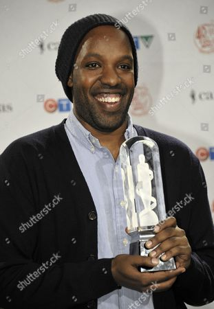 Stock Picture of Kenyan-born Canadian-raised Musician Shadrach (shad) Kabango Holds His Juno Award For 'Rap Recording of the Year' For His Song 'Tsol' at the 40th Annual Canadian Music Awards in Toronto Canada on 26 March 2011 the Awards Event Continues on 27 March 2011 with a Tv Broadcast of More Awards and Performances Canada Toronto