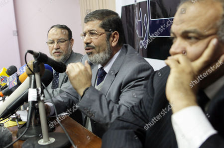 (l-r): Egypt's Muslim Brotherhood Representatives Essam El-arian Mohamed Morsi and Saad Al-katatni Address a Press Conference in Cairo Egypt 06 February 2011 a Broad Range of Egyptian Opposition Groups Sat Down on 06 February For the First Talks with the Government As the Country Entered Its 13th Day of Unrest But with the Spotlight Turning Towards Some Form of Negotiated Outcome However the Talks Appeared to Be Inconclusive Beyond Highlighting the Wide Gap Still Separating Opposition Demands From Government Concessions 'I Cannot See Any Seriousness on Behalf of the Regime ' Abdul Monim Abo Al-fotoh From the Muslim Brotherhood Told Broadcaster Al-jazeera Egypt Cairo