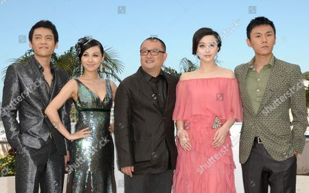 Chinese Director Wang Xiaoshuai (c) Poses with Chinese Actors and Cast Members Zi Yi (l) Li Feier (2-l) Fan Bingbing (2-r) and Qin Hao (r) During the Photocall of the Movie 'Rizhao Chongqing' (chongqing Blues) During the 63rd Cannes Film Festival in Cannes France 13 May 2010 the Movie by Chinese Director Wang Xiaoshuai is Presented in Competition at the Cannes Film Festival 2010 Running From 12 to 23 May France Cannes