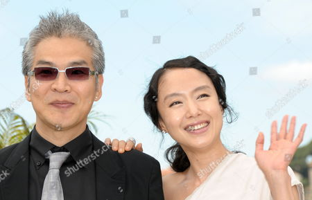 South-korean Director Im Sang-soo (l) and South-korean Actress Jeon Do-youn (r) Pose During the Photocall of the Movie 'The Housemaid' During the 63rd Cannes Film Festival in Cannes France 14 May 2010 the Movie by Im Sang-soo is Presented in Competition at the Cannes Film Festival 2010 Running From 12 to 23 May France Cannes