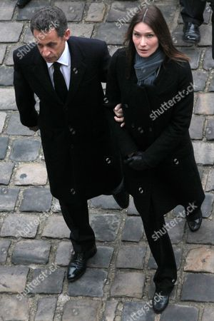 French President Nicolas Sarkozy (l) and His Wife Carla Bruni-sarkozy Attend the Funeral of Former French Politician and President of the 'Cour Des Comptes' (france's Public Finance Watchdog Committee) Philippe Seguin (pictured on the Poster) During the Funeral Ceremony at Invalides in Paris France 11 January 2010 Seguin an Influential and Eurosceptic French Politician Died of a Heart Attack on 07 January 2010 Aged 66 France Paris