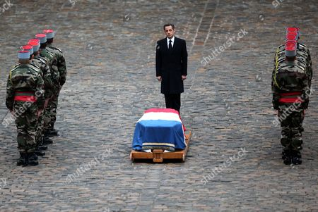 French President Nicolas Sarkozy Pays His Respects to Former French Politician and President of the 'Cour Des Comptes' (france's Public Finance Watchdog Committee) Philippe Seguin (pictured in the Poster) During the Funeral Ceremony at Invalides in Paris France 11 January 2010 Seguin an Influential and Eurosceptic French Politician Died of a Heart Attack on 07 January 2010 Aged 66 France Paris