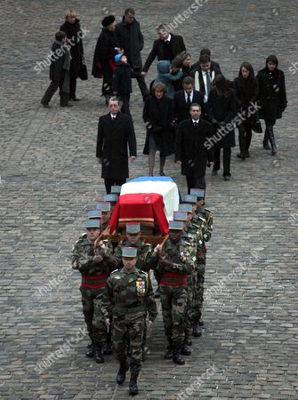 French President Nicolas Sarkozy (3-l Rear) His Wife Carla Bruni-sarkozy (to His Right) and Members of the Seguin Family Follow the Coffin of Former French Politician and President of the 'Cour Des Comptes' (france's Public Finance Watchdog Committee) Philippe Seguin During the Funeral Ceremony at Invalides in Paris France 11 January 2010 Seguin an Influential and Eurosceptic French Politician Died of a Heart Attack on 07 January 2010 Aged 66 France Paris