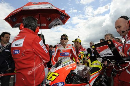 Stock Image of Italian Motogp Rider Valentino Rossi (c) of Ducati Marlboro Team Prepares For the Motorcycling Grand Prix of France in Le Mans France 15 May 2011 Rosi Placed Third France Le Mans