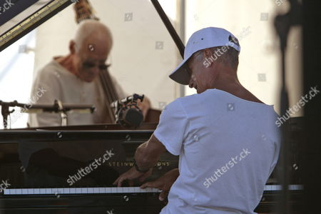 Uncropped Version of Epa01417768 ------------------------------ Us Jazz Pianist Keith Jarrett (r) Performs with Gary Peacock (bass) and Jack Dejohnette (drum Unseen) During a Rehearsal of the 48th 'Jazz a Juan' Festival in Antibes Juan Les Pins France 18 July 2008 the Festival Takes Place From 10 to 20 July 2008 France Antibes Juan Les Pins