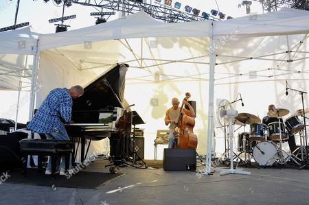 Stock Picture of Us Jazz Pianist Keith Jarrett (l) Performs with Us Double-bassist Gary Peacock and Us Drummer Jack Dejohnette During a Rehearsal of the 51st 'Jazz a Juan' Festival in Antibes Juan Les Pins France 16 July 2011 the Festival Takes Place From 14 to 24 July 2011 France Antibes Juan Les Pins