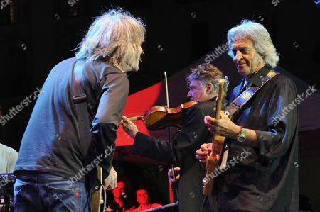 Stock Photo of British Guitar Player and Patron of the Nice Jazz Festival 2011 John Mac Laughlin (r) Performs with Us Guitar Player Mike Stern (l) and French Composer and Violinist Didier Lockwood (c) During the Opening Night of the Festival in Nice France 08 July 2011 the Festival Takes Place From 08 to 12 July For the 2011 Edition the Event is in Center of Nice Near the Beach Instead of the Usual Venue Since 1974 France Nice