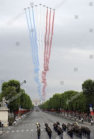 Colours Representing the French Tricolour Are Left Trailing Across the Skyline As Nine Alphajets of 'La Patrouille De France' French Air Force Acrobatic Team Fly Over the Champs Elysees Avenue Before French President Nicolas Sarkosy and 14 African Heads of State and Government on Occasion of the Bastille Day Military Parade in Paris France 14 July 2010 This Year the Former French Black Africa Colonies Have Been Made Guests of Honor and Their Flags Presides Over the Parade France Paris