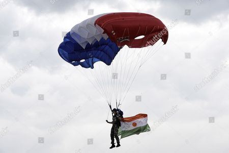 A French Military Parachutist Carrying Niger Flag is About to Land on Place Concorde Before French President Nicolas Sarkosy and 14 African Heads of State and Government on Occasion of the Bastille Day Military Parade in Paris France 14 July 2010 This Year the Former French Black Africa Colonies Have Been Made Guests of Honor and Their Flags Presides Over the Parade France Paris