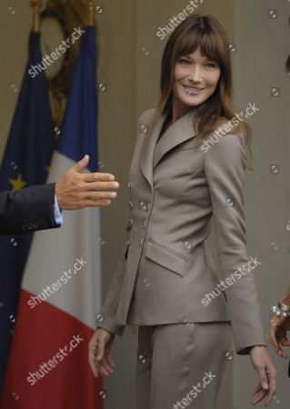 French First Lady Carla Bruni Sarkozy Smile As Tshe Greets Princess Victoria of Sweden and Her Husband Prince Daniel at Elysee Palace in Paris France 28 September 2010 on the Third Day of the Swedish Royal Couple's Official Visit to France Crown Princess Victoria of Sweden and Prince Daniel Westling Are on a Four Days Official Visit to France France Paris
