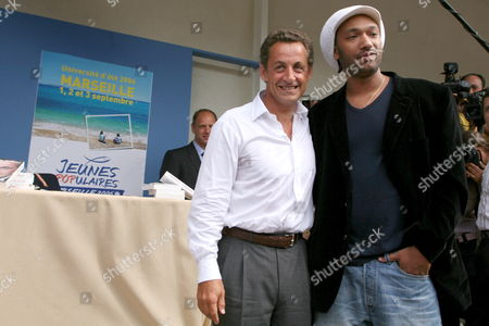 French Interior Minister Nicolas Sarkozy (l) Meets with Well-known French Artist Doc Gyneco (r) Attends the End-of-summer Gathering of the Governing Centre-right Party the Ump in Marseille France Saturday 02 September 2006 France Marseille