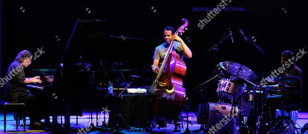 Stock Picture of The Members of 'Power of Three' Us Pianist Chick Corea (l) Bass Stanley Clark (c) and Drummer Lenny White (r) Perform During the Last Night of the Skopje's Jazz Festival in Skopje the Former Yugoslav Republic of Macedonia Late 26 October 2009 Macedonia, the Former Yugoslav Republic of Skopje