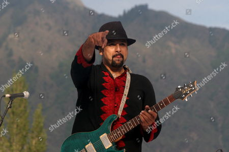 Uncropped Version of Epa01357367 --------------------------- Salman Ahmad Lead Singer of Pakistani Rock Band Junoon Performs During a Concert in Srinagar Indian Kashmir 25 May 2008 Thousands of Strife Weary Kashmiris Usually Accustomed to Sound of Bombs and Rattle of Gunfire Screamed with Joy Clapped and Danced to the Beat of Music by Junoon the Concert Biggest Musical Event in the Disputed Kashmir Region in Nearly Two Decades in a Bid For Peace was Held Amid Tight Security on the Banks of Region's Famous Dal Lake Ringed by Lofty Himalayan India Srinagar
