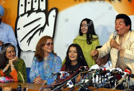 (from L) Bollywood Actresses Namrata Shirodkar Zeenat Amanand and Celina Jaitley Laugh As Bollywood Comedian Asrani (r) Makes a Joke During a Press Conference in New Delhi On Friday 05 March 2004 After They Joined India's Main Opposition Congress Party Many Celebrities Joined the Congress Party Led by Sonia Ghandi As India Heads Into Elections Expected Around April-may (woman at Rear is Unidentified)
