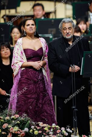 Spanish Tenor Placido Domingo Addresses to the Audience Before Performing a Japanese Song Called 'Furusato' Or 'Hometown' with Argentinean Soprano Virginia Tola (l) During a Concert in Tokyo Japan 10 March 2011 Domingo Expressed His Sympathy For the Japanese People After the Country Suffered Its Worst Disaster Since Wwii with the 11 March Devastating Earthquake and Tsunami the Spanish Tenor is in Japan to Perform Two Tokyo Shows Japan Tokyo