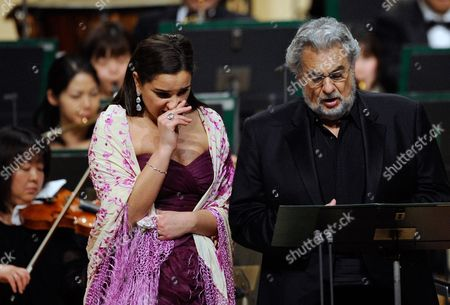 Spanish Tenor Placido Domingo Performs a Japanese Song Called 'Furusato' Or 'Hometown' As Argentinean Soprano Virginia Tola (l) Gets Emotional During a Concert in Tokyo Japan 10 March 2011 Domingo Expressed His Sympathy For the Japanese People After the Country Suffered Its Worst Disaster Since Wwii with the 11 March Devastating Earthquake and Tsunami the Spanish Tenor is in Japan to Perform Two Tokyo Shows Japan Tokyo
