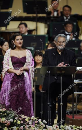 Stock Photo of Spanish Tenor Placido Domingo Applauds After Performing a Japanese Song Called 'Furusato' Or 'Hometown' with Argentinean Soprano Virginia Tola (l) During a Concert in Tokyo Japan 10 March 2011 Domingo Expressed His Sympathy For the Japanese People After the Country Suffered Its Worst Disaster Since Wwii with the 11 March Devastating Earthquake and Tsunami the Spanish Tenor is in Japan to Perform Two Tokyo Shows Japan Tokyo