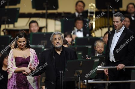Spanish Tenor Placido Domingo (c) Addresses to the Audience Before Performing a Japanese Song Called 'Furusato' Or 'Hometown' with Argentinean Soprano Virginia Tola (l) As Conductor Eugene Kohn (r) Looks on During a Concert in Tokyo Japan 10 March 2011 Domingo Expressed His Sympathy For the Japanese People After the Country Suffered Its Worst Disaster Since Wwii with the 11 March Devastating Earthquake and Tsunami the Spanish Tenor is in Japan to Perform Two Tokyo Shows Japan Tokyo