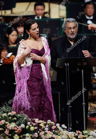 Stock Image of Spanish Tenor Placido Domingo Performs a Japanese Song Called 'Furusato' Or 'Hometown' with Soprano Virginia Tola (l) During a Concert in Tokyo Japan 10 March 2011 Domingo Expressed His Sympathy For the Japanese People After the Country Suffered Its Worst Disaster Since Wwii with the 11 March Devastating Earthquake and Tsunami the Spanish Tenor is in Japan to Perform Two Tokyo Shows Japan Tokyo