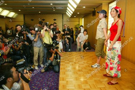 Russian All-girl Teen Pop Duo 'T a T U Julia Volkova (r) and Lena Katina Stand in the Middle of Intense Media Interest While Posing For Photos During a Press Conference in a Hotel in Tokyo 29 June 2003 More Than 200 Reporters Crowded the Small Space the Singers Cancelled a Few of the Planned Television Performances During Their Visit to Japan at the Last Moment Epa Photo/epa/kei Ishida Japan Tokyo