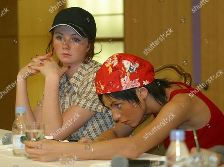 Russian All-girl Teen Pop Duo 'T a T U Julia Volkova (r) and Lena Katina Listen to Questions During a Press Conference in a Hotel in Tokyo 29 June 2003 More Than 200 Reporters Crowded the Small Space the Singers Cancelled a Few of the Planned Television Performances During Their Visit to Japan at the Last Moment Epa Photo/epa/kei Ishida Japan Tokyo