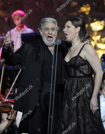 Stock Photo of Spanish Tenor Placido Domingo (l) and Argentinian Soprano Virginia Tola (r) Perform on the Main Stage at the Opening Night of the Zouk Mikael International Festival in Zouk Mikael North of Beirut Lebanon Late 17 July 2011 the Festival Runs From 17 to 21 July 2011 Lebanon Zouk