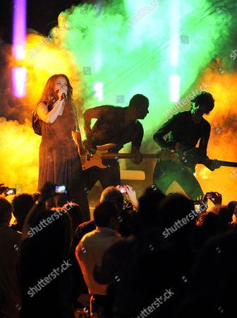 French Singer Helene Segara (l) Performs on Stage During a Concert at Edde Sand's Resort in Byblos (jbeil) North Beirut Lebanon 21 May 2010 Lebanon Byblos
