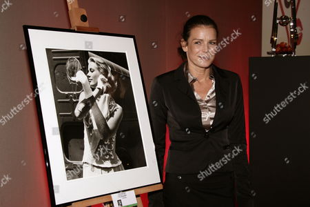 President of the Association 'Fight Aids Monaco' Princess Stephanie of Monaco Poses with a Photograph of Her Mother Grace Kelly by Edward Quinn During the Filming of 'To Catch a Thief' (1954) of Alfred Hitchcock in Cannes As She Attends the 'Fight Aids Monaco' Annual Charity Auction Sale at the Sea Club Meridien Hotel to Commemorate the World Aids Day in Monaco 01 December 2009 Monaco Monaco