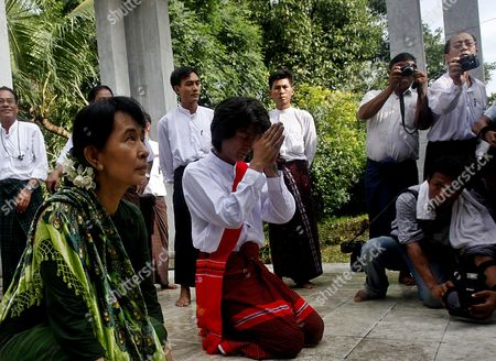 Myanmar Democracy Leader Aung San Suu Kyi (l) and Her Son Kim Aris (2-l) Pay Homage at the Tomb of Late Daw Khin Kyi Her Mother in Yangon Myanmar 12 July 2011 Suu Kyi Will Go on a Political Tour After Martyr's Day on 19 July 2011 Myanmar Yangon