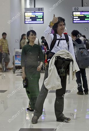 Myanmar Democracy Leader Aung San Suu Kyi (l) and Her Younger Son Kim Aris (r) Before His Departure at the Yangon International Airport Myanmar 12 July 2011 Myanmar Yangon