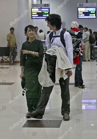 Myanmar Democracy Leader Aung San Suu Kyi (l) Talks with Her Younger Son Kim Aris (r) Before His Departure at the Yangon International Airport Myanmar 12 July 2011 Myanmar Yangon