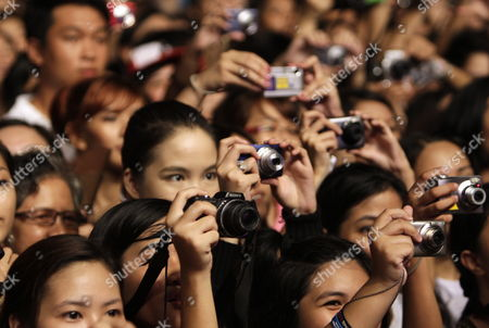 Concert-goers Take Pictures of South Korean Singer Jung Ji-hoon (unseen) Aka Rain Performing During a Concert at Sm Mall of Asia Open Grounds in Pasay City Philippines 11 September 2010 the Concert was His Last Performance Before He Enters the Korean Military Service Which is Compulsory For All the Male Citizens in Korea Philippines Manila