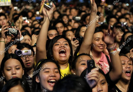 Concert-goers Cheer As South Korean Singer Jung Ji-hoon (unseen) Aka Rain Performs During a Concert at Sm Mall of Asia Open Grounds in Pasay City Philippines 11 September 2010 the Concert was His Last Performance Before He Enters the Korean Military Service Which is Compulsory For All the Male Citizens in Korea Philippines Manila