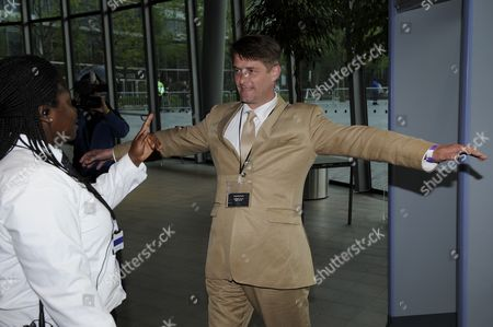 BNP Mayoral candidate Richard Barnbrook is searched by a security guard after setting off metal detectors when entering City Hall