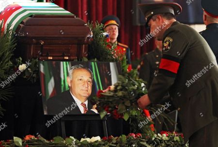 Russian Soldier Lays Flowers at the Coffin of Late Abkhaz President Sergei Bagapsh During a Farewell Ceremony in Moscow Russia 30 May 2011 President Sergei Bagapsh of the Breakaway Georgian Region of Abkhazia Has Died in Moscow Hospital Following a Lung Operation Officials in the Russian Capital Said on 29 May Russian Federation Moscow
