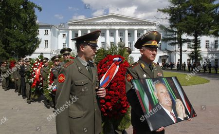 Soldiers Carry a Portrait of Late Abkhaz President Sergei Bagapsh in Front of the Armed Forces' Culture Center During a Farewell Ceremony in Moscow Russia 30 May 2011 President Sergei Bagapsh of the Breakaway Georgian Region of Abkhazia Has Died in Moscow Hospital Following a Lung Operation Officials in the Russian Capital Said on 29 May Russian Federation Moscow