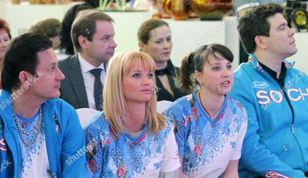 Famous Russian Actor Oleg Menshikov (l) Artistic Gymnastics Olimpic Champion Svetlana Khorkina (second L) Olympic Medal Winner in Figure Skating Irina Slutskaya (second R) and Famous Russian Pianist Denis Matsuyev (r) Dressed in T-shirts Presenting Visual Design of Sochi 2014 Attend a Presentation of a Concept of an Integrated Visual Look of Xxii Olympic Winter Games and Xi Paraolympic Winter Games 2014 in Moscow Russia 25 April 2014 Russian Federation Moscow